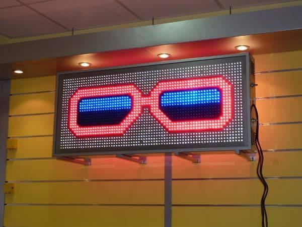 Rótulo luminoso para óptica tipo Gafas de Leds 119x54 cm. LED rojo+azul+blanco